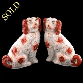 Pair of Staffordshire Pottery Dogs