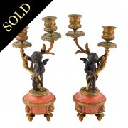 Pair of Bronze Cupid Candlesticks