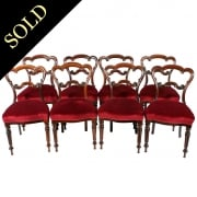 Eight Rosewood Dining Chairs